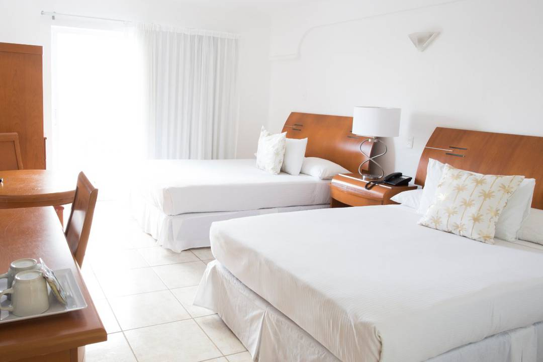 Deluxe ocean front double rooms coral princess golf & dive resort hotel cozumel